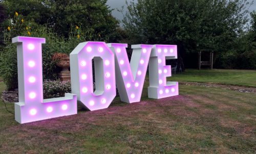 LOVE letters in soft pink for a party in the garden
